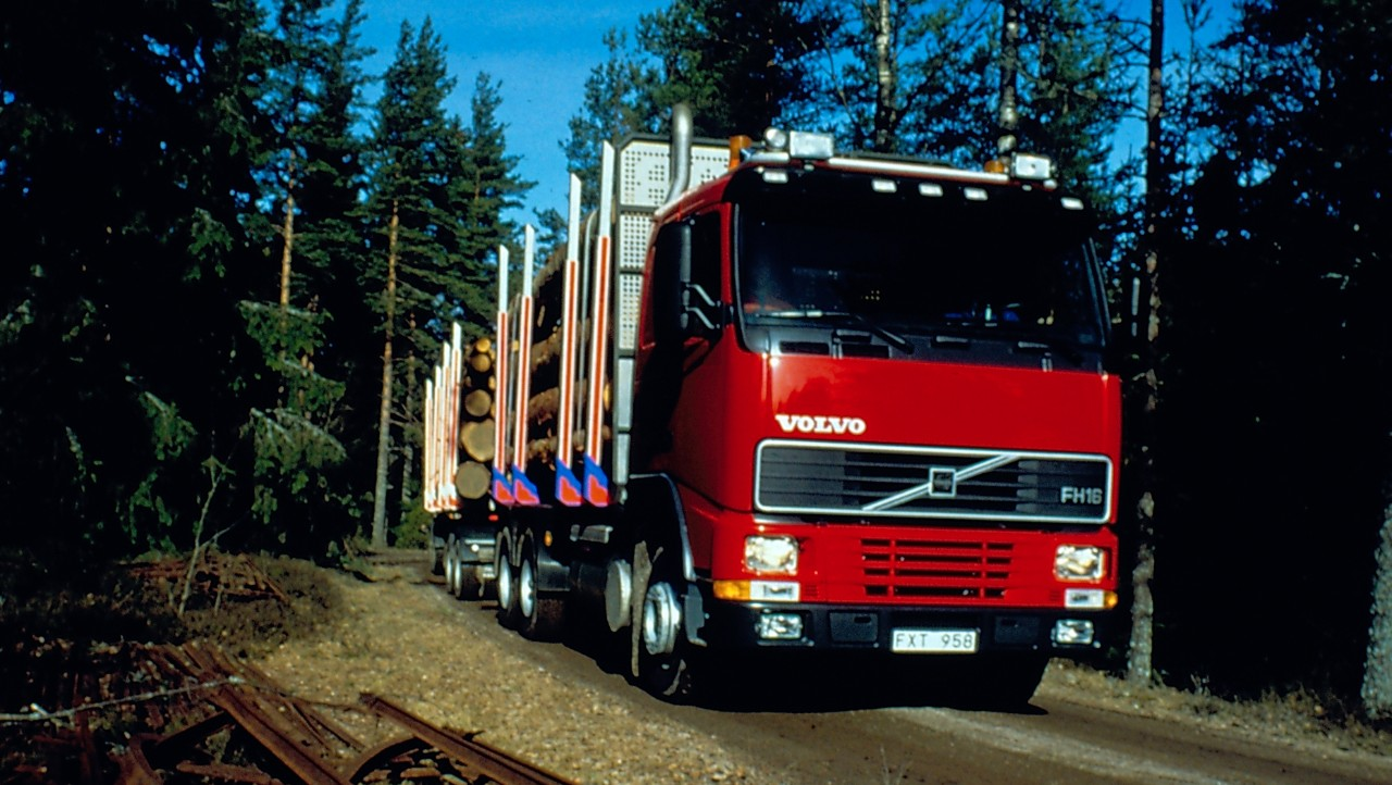 A Volvo FH in driving downhill in forest
