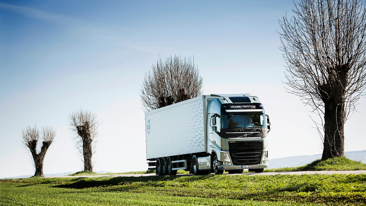 Volvo FH driving in green landscape