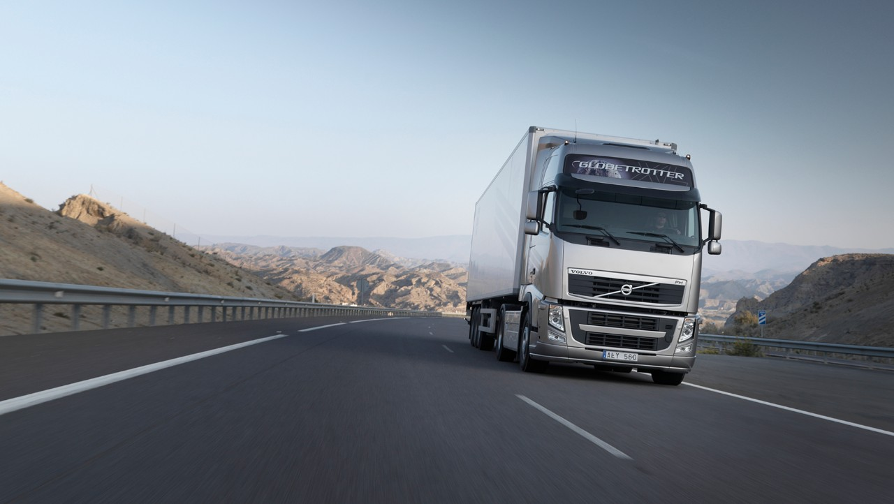 White Volvo FH driving uphill