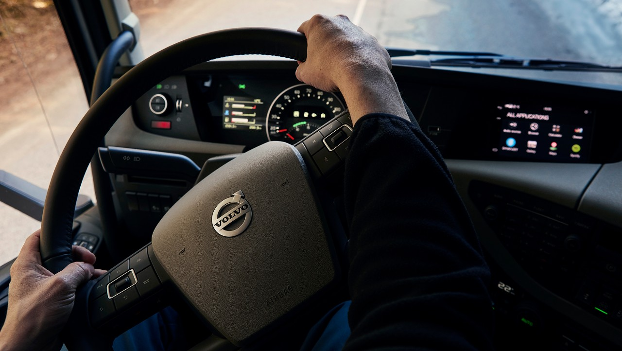 Two hands on the driving wheel